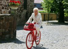 Lucky bride drives a red retro bike to the wedding stock images