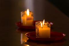 Lucky burning candle on black background at Wat Borom Raja Kanja Stock Photography