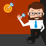 Lucky businessman is presenting a target Royalty Free Stock Photos