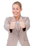 Lucky businesswoman with thumbs up Stock Photos