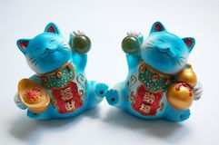 Lucky cat. Pair of lucky cat with white background stock photography