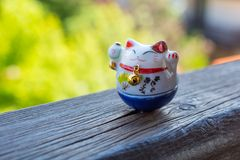Lucky Cat in blue color. Maneki Neko - Lucky Cat in blue color - for study and career Royalty Free Stock Image