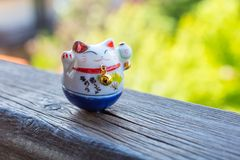 Lucky Cat in blue color. Maneki Neko - Lucky Cat in blue color - for study and career stock photography
