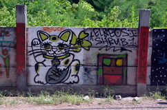 Lucky Cat. GILI TRAWANGAN, INDONESIA, MAY 24, 2015 - Maneki-neko (Lucky Cat), graffiti on the island of Gili Trawangan, Indonesia royalty free stock photo