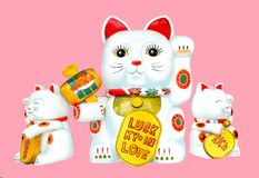 Lucky cat of luck and good luck. Paper dolls are a symbol of luck in love and work royalty free stock photo