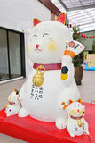 Lucky cat (Maneki neko) statue. In Bangkok park, Thailand royalty free stock image