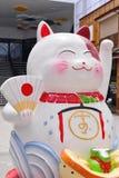 Lucky cat (Maneki neko) statue. In Bangkok park, Thailand stock photos