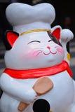 Lucky cat (Maneki neko) statue. In Bangkok park, Thailand royalty free stock photo