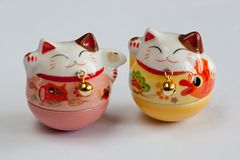 Lucky Cats. Maneki Neko - Lucky Cats in White Background Stock Photos