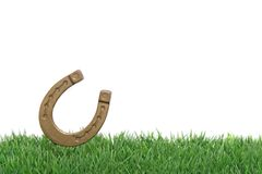 Lucky Chance. A horseshoe on a green meadow symbolizing a lucky chance. All on white background stock photo