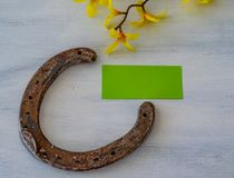 A lucky charm. Horseshoe with a blank note stock image
