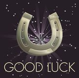 Lucky charm horseshoe illustration on abstract background. Shiny metal horse shoe for hoof forge, good luck wording, supersticion symbol for riches Royalty Free Stock Photography