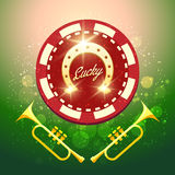 Lucky Chip. Horseshoe Casino chip with lettering Lucky and two trumpets against festive background Royalty Free Stock Image