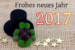 Lucky clover, a cylinder hat and stars for New Year 2017 Stock Images