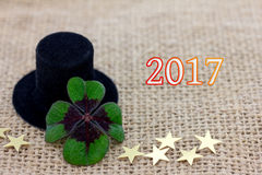 Lucky clover, a cylinder hat and stars for New Year 2017 Royalty Free Stock Images