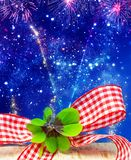 Lucky clover in front of New Year`s Eve sky with fireworks royalty free stock photography