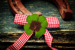 Lucky clover and horseshoe. Lucky clover, horseshoe and bow tie royalty free stock photos