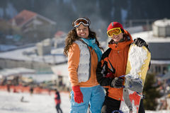 Lucky couple  snowboarders Stock Images
