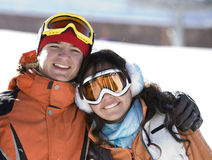 Lucky couple  snowboarders  in a mountain Royalty Free Stock Photos