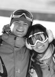 Lucky couple snowboarders in a mountain valley royalty free stock photo