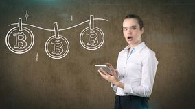Lucky cute lady and bitcoin investment. Concept of mining and virtual criptocurrency. Successful money making. Lucky lady and bitcoin investment. She needs to stock image