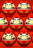 Lucky Daruma Dolls On Red Royalty-vrije Stock Afbeelding