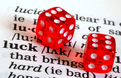 Lucky dice. Dictionary definition of the word luck with two red dice showing six Royalty Free Stock Photos