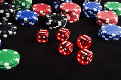 Lucky dice and chips. Lucky dice all come up six winning a lot of casino chips royalty free stock photos