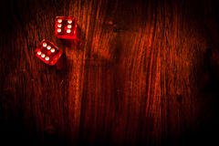 Lucky dice gamling. Two red dices with a luckycharm four-leaf clover Stock Photography