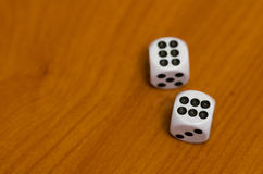 Lucky dice orange background Royalty Free Stock Image