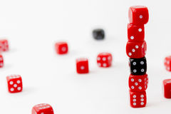 Lucky dices. PIle of red and black dices in order from one to six with other dices in background Royalty Free Stock Photography