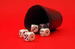 Lucky dices rolling. Dices rolling out from on red table Royalty Free Stock Photos