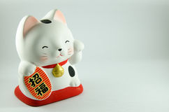 Lucky Doll Cat. Japanese characters means good luck or fortune royalty free stock photos