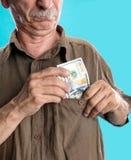 Lucky elderly man holding dollar bills Stock Photo