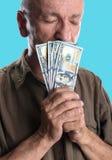 Lucky elderly man holding dollar bills Stock Image