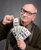 Lucky elderly man holding dollar bills Royalty Free Stock Images