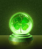 Lucky four-leaf clover inside the crystal ball. Lucky four-leaf clover seen inside the crystal scrying ball Royalty Free Stock Photography