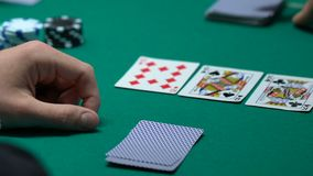 Lucky gambler checking cards, winning combination in poker, ace-high straight. Stock footage stock footage