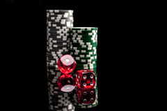 Lucky Game of Dice. Dice and chips  on black background with reflexion Royalty Free Stock Photo
