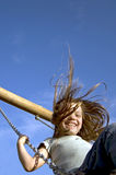 Lucky Girl. Girl swinging with a big smile Royalty Free Stock Photography