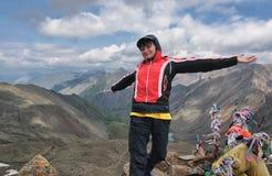 Lucky girl conqueror of mountains Stock Photography