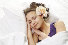 Lucky girl sleeps in a bed Royalty Free Stock Photo