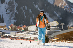 Lucky girl snowboarder Royalty Free Stock Photography
