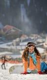 Lucky girl snowboarder Stock Photo