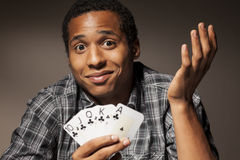 Lucky guy. Young man with compassion holds the winning poker cards Stock Photo