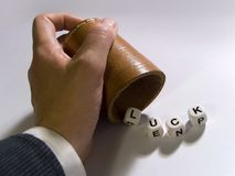 Lucky hand. Luck written by letter dice Royalty Free Stock Photography