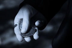 Lucky hand. Black merchant with his money Stock Photos