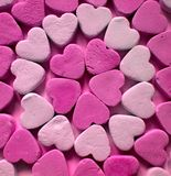 Lucky heart. Rows of pink lucky hearts royalty free stock photo