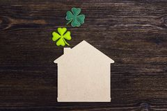Lucky home symbol with four-leaf clover on wooden background. Co. Py space. St.Patrick`s day holiday symbol royalty free stock photo