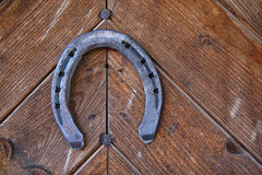Lucky horseshoe. On the old door Stock Photography